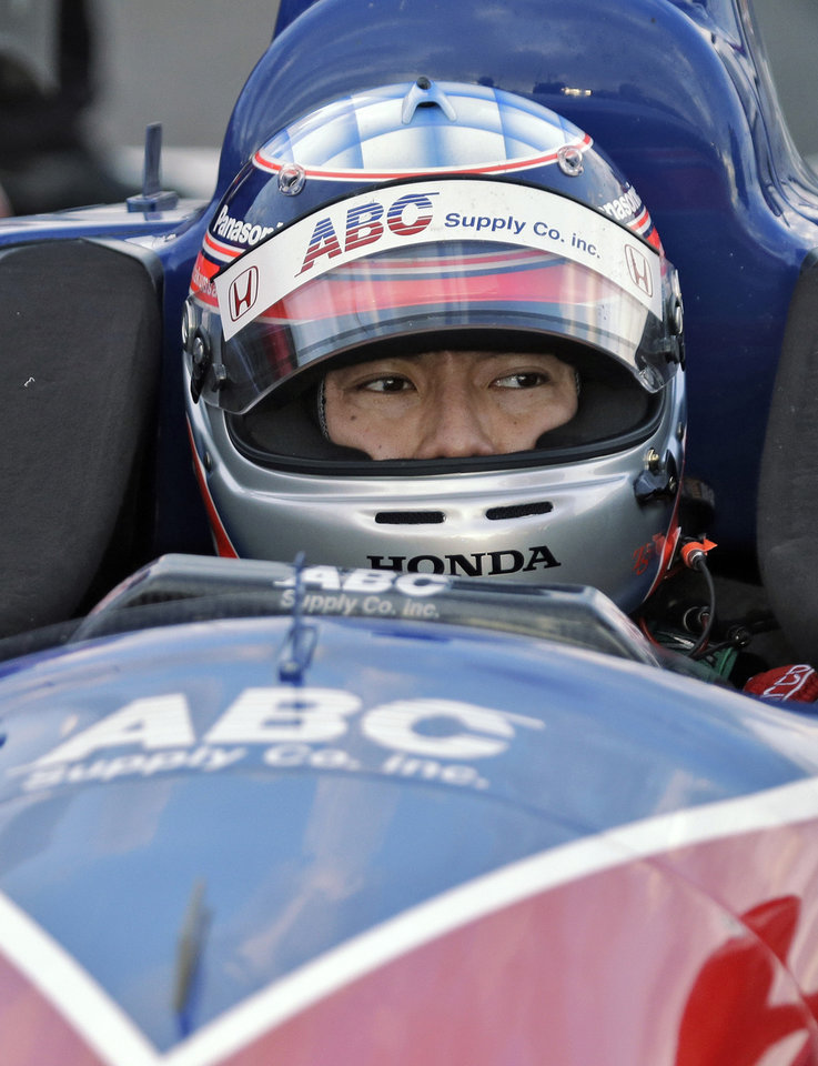 Photo - Takuma Sato, of Japan, sits in his car after qualifying for the pole position for the IndyCar Firestone Grand Prix of St. Petersburg auto race Saturday, March 29, 2014, in St. Petersburg, Fla. The race takes place on Sunday. (AP Photo/Chris O'Meara)
