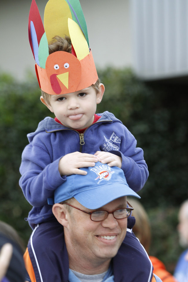 Above: Rusty Finley and his son Zach, age 3, wait for the start of the Turkey Trot on Thursday in Edmond.