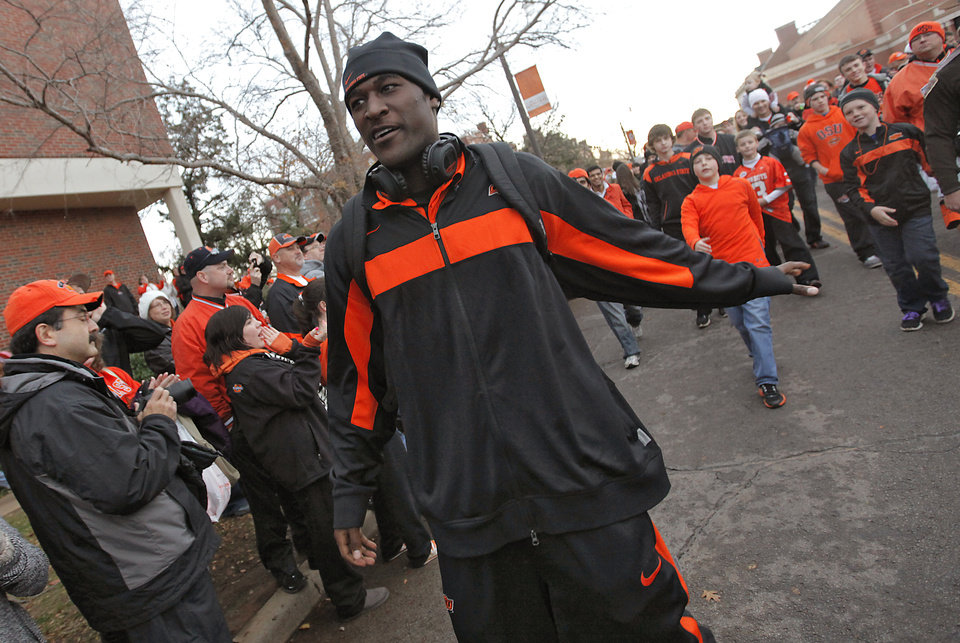 Photo - Justin Blackmon interacts with fans while taking part in the 'Spirit Walk' before the Bedlam college football game between the Oklahoma State University Cowboys (OSU) and the University of Oklahoma Sooners (OU) at Boone Pickens Stadium in Stillwater, Okla., Saturday, Dec. 3, 2011. Photo by Chris Landsberger, The Oklahoman