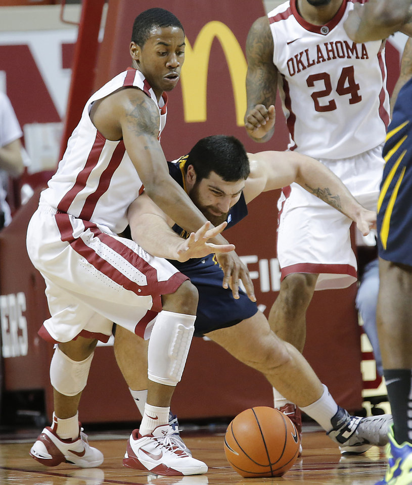 Oklahoma's Je'lon Hornbeak (5) defends on West Virginia 's Deniz Kilicli (13) during the second half of the college basketball game between the University of Oklahoma Sooners (OU) and the West Virginia University Mountaineers (WVU) at the Lloyd Noble Center on Wednesday, March 6, 2013, in Norman, Okla. Photo by Chris Landsberger, The Oklahoman
