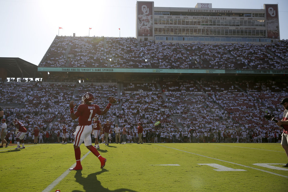 Photo - Oklahoma's Jalen Hurts (1) warms up prior to a college football game between the University of Oklahoma Sooners (OU) and the Houston Cougars at Gaylord Family-Oklahoma Memorial Stadium in Norman, Okla., Sunday, Sept. 1, 2019. [Bryan Terry/The Oklahoman]