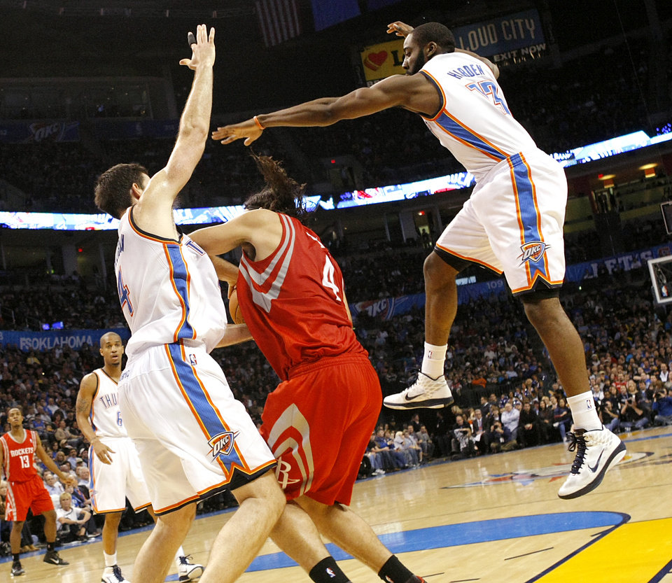 Photo - Oklahoma City's Nick Collison and James Harden pressure Houston's Luis Scola during their NBA basketball game at the OKC Arena in downtown Oklahoma City on Wednesday, Nov. 17, 2010. Photo by John Clanton, The Oklahoman