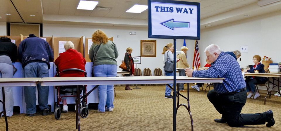 Photo - Voters find any available spot to fill out their ballot during election day on Tuesday, Nov. 6, 2012, in Yukon, Oklahoma. Photo by Chris Landsberger, The Oklahoman