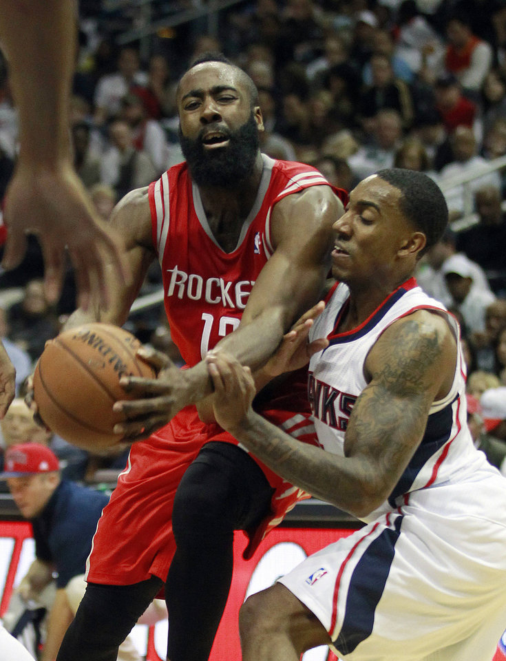 Houston Rockets shooting guard James Harden (13) drives against Atlanta Hawks point guard Jeff Teague, right, in the second half of an NBA basketball game on Friday, Nov. 2, 2012, in Atlanta. Houston won 109-102. (AP Photo/John Bazemore)