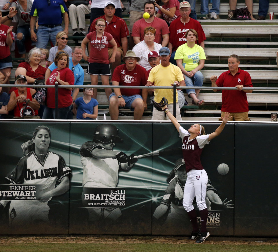 Photo - Sooner pitcher Keilani Ricketts home run goes over the fence to end the game at the NCAA Super Regional softball game as the University of Oklahoma (OU) Sooners defeats Texas A&M 10-2 at Marita Hines Field on Friday, May 24, 2013 in Norman, Okla. Photo by Steve Sisney, The Oklahoman