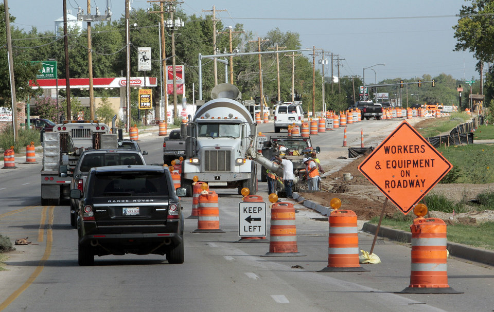 Traffic on Classen Boulevard near Imhoff Road in Norman narrows to two lanes as work continues on improving the intersection and widening a one-mile stretch of Classen between Imhoff and Constitution Avenue.  PHOTO BY STEVE SISNEY, THE OKLAHOMAN