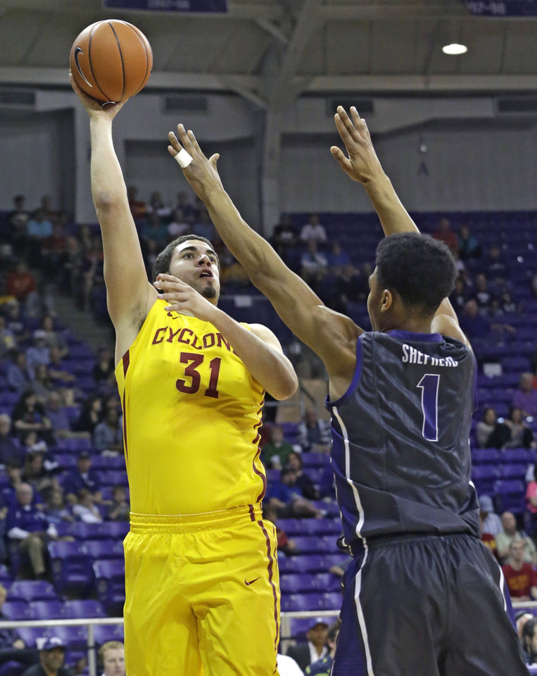 Photo - Iowa State forward Georges Niang (31) shoots against TCU center Karviar Shepherd (1) during the first half of an NCAA college basketball game Saturday, Feb. 22, 2014, in Fort Worth, Texas. (AP Photo/LM Otero)
