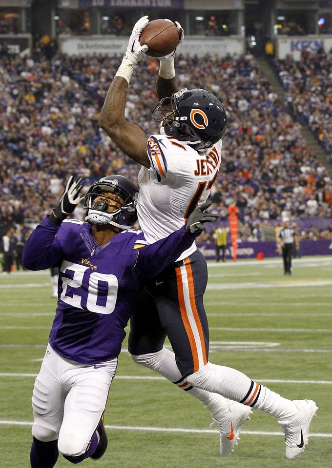 Chicago Bears wide receiver Alshon Jeffery catches a 46-yard touchdown pass over Minnesota Vikings cornerback Chris Cook (20) during the second half of an NFL football game on Sunday, Dec. 1, 2013, in Minneapolis. (AP Photo/Ann Heisenfelt)