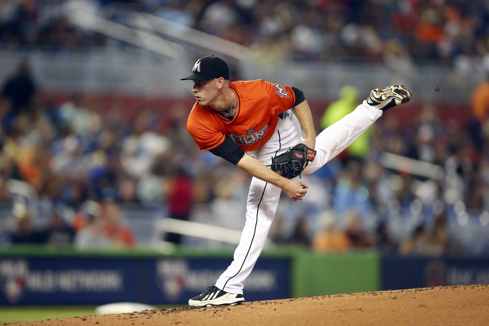 Photo - Miami Marlins' Anthony DeSciafani pitches to the New York Mets during the second inning of a baseball game in Miami, Sunday, June 22, 2014.  (AP Photo/J Pat Carter)