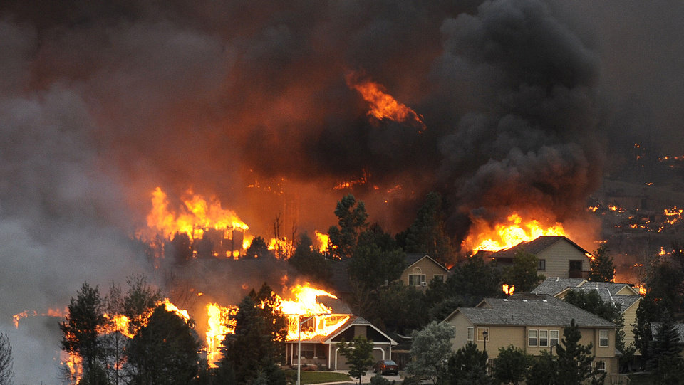 Photo -   An entire neighborhood burns near the foothills of Colorado Springs, Colo. on Tuesday, June 26, 2012. A towering wildfire destroyed dozens of houses overnight, though the intensity of the blaze kept officials Wednesday from being able to fully assess the damage to the state's second-largest city. (AP Photo/The Denver Post, Helen H. Richardson) MAGS OUT; TV OUT; INTERNET OUT