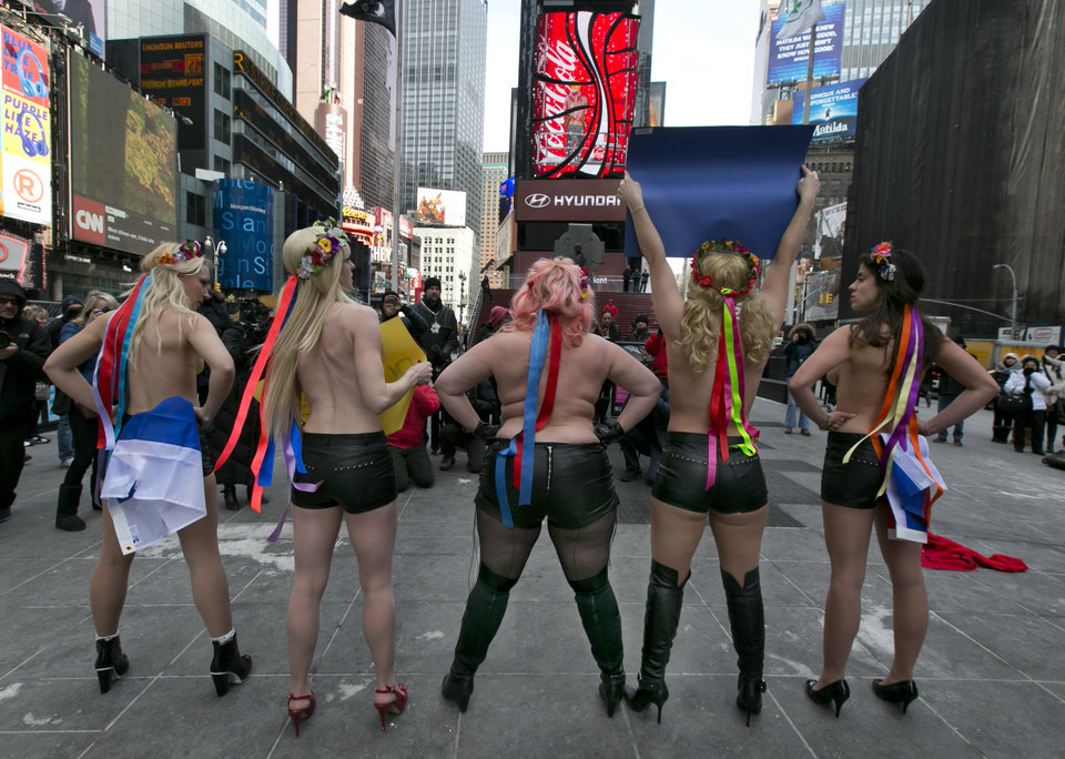 Photo - EDS NOTE: NUDITY - Female activist members of FEMEN go topless during their anti-Putin, pro-Ukraine demonstration in New York's Times Square, Thursday, March 6, 2014. (AP Photo/Richard Drew)