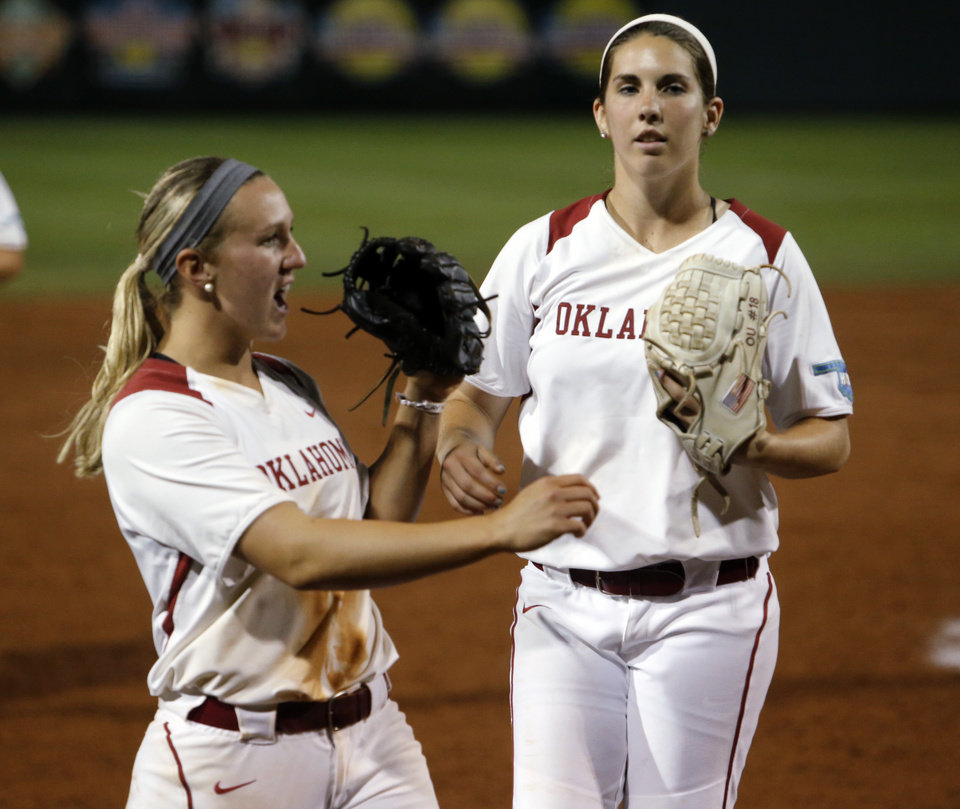 Photo - Oklahoma's Shelby Pendley, left, and pitcher Kelsey Stevens celebrate the end of the game and the victory as the University of Oklahoma Sooner (OU) softball team plays Tennessee in the first game of the NCAA super regional at Marita Hynes Field on May 23, 2014 in Norman, Okla. Photo by Steve Sisney, The Oklahoman