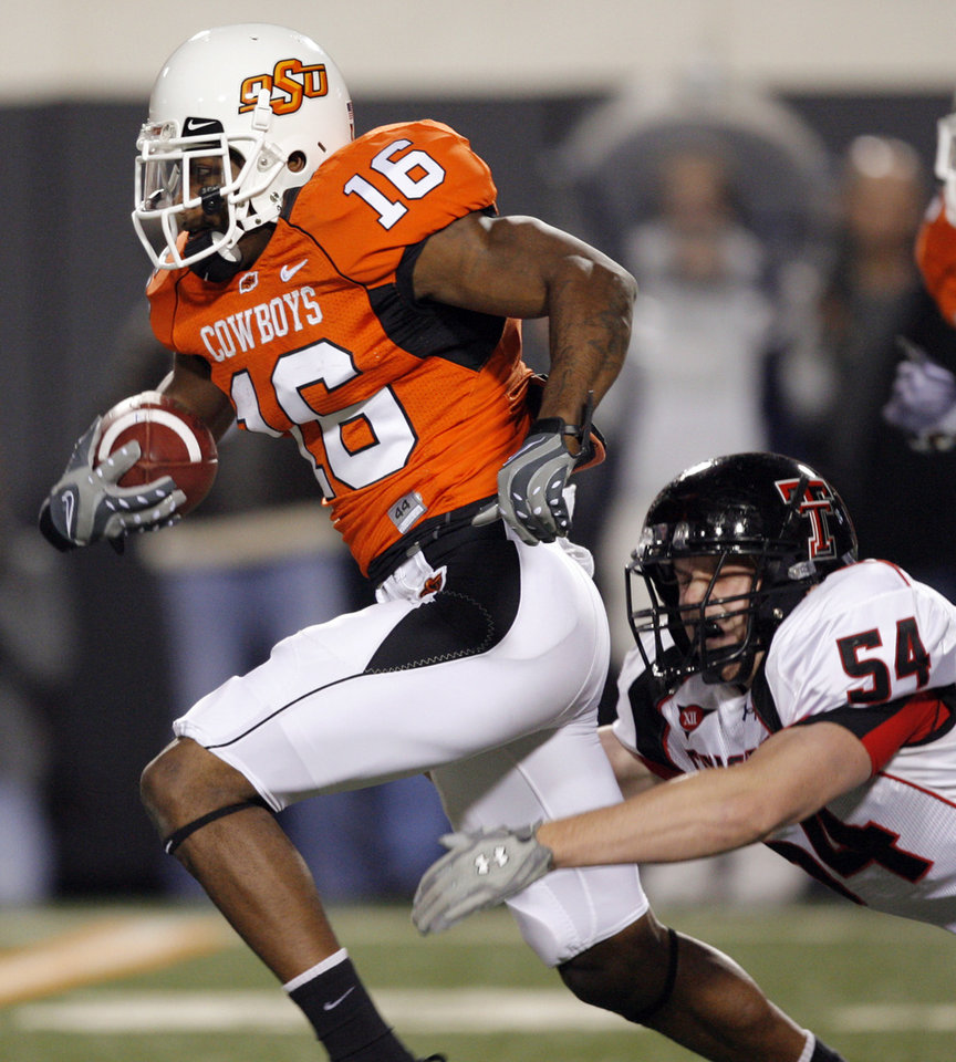 OSU's Perrish Cox (16) tries to break away from Riley Harvey (54) of Texas Tech on a punt return during the college football game between Oklahoma State University (OSU) and Texas Tech University (TTU) at Boone Pickens Stadium in Stillwater, Okla. Photo by Nate Billings, The Oklahoman
