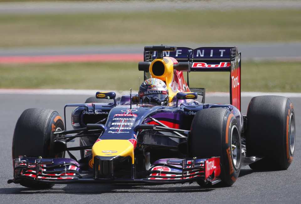 Photo - Germany's Sebastian Vettel of Red Bull rounds the track during a practice session before the British Formula One Grand Prix at Silverstone circuit, Silverstone, England, Friday, July 4, 2014. The British Formula One Grand Prix will be held on Sunday, July 6, 2014. (AP Photo/Lefteris Pitarakis)