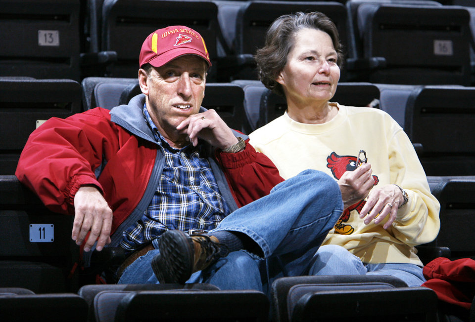 Photo - Iowa State fans Herb and JoEllin Dickkut watched the Cyclones practice on Tuesday.   PHOTO BY CHRIS LANDSBERGER, the Oklahoman
