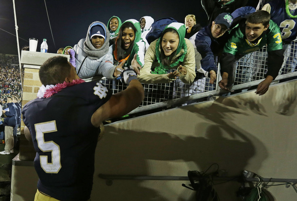In this Sept. 22, 2012 photo, Notre Dame\'s Manti Te\'o (5) celebrates with fans after Notre Dame defeated Michigan, 13-6, in an NCAA college football game in South Bend, Ind. Notre Dame defensive coordinator Bob Diaco believes Te'o is the finest football player in college. (AP Photo/Darron Cummings)