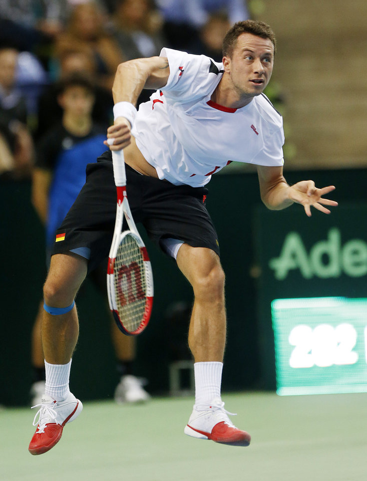 Photo - Germany's Philipp Kohlschreiber serves against Spain's Roberto Bautista Agut during a Davis Cup World Group first round tennis match between Germany and Spain in Frankfurt, Germany, Friday, Jan. 31, 2014. (AP Photo/Michael Probst)