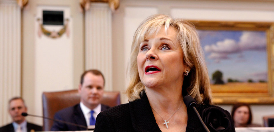 Photo - Gov. Mary Fallin delivers her 2012 State of the State address to a joint session of the Oklahoma legislature in the House Chamber on the opening day of the session, Monday, Feb, 6, 2012. Seated behind Fallin is Lt. Gov. Todd Lamb.   Photo by Jim Beckel, The Oklahoman