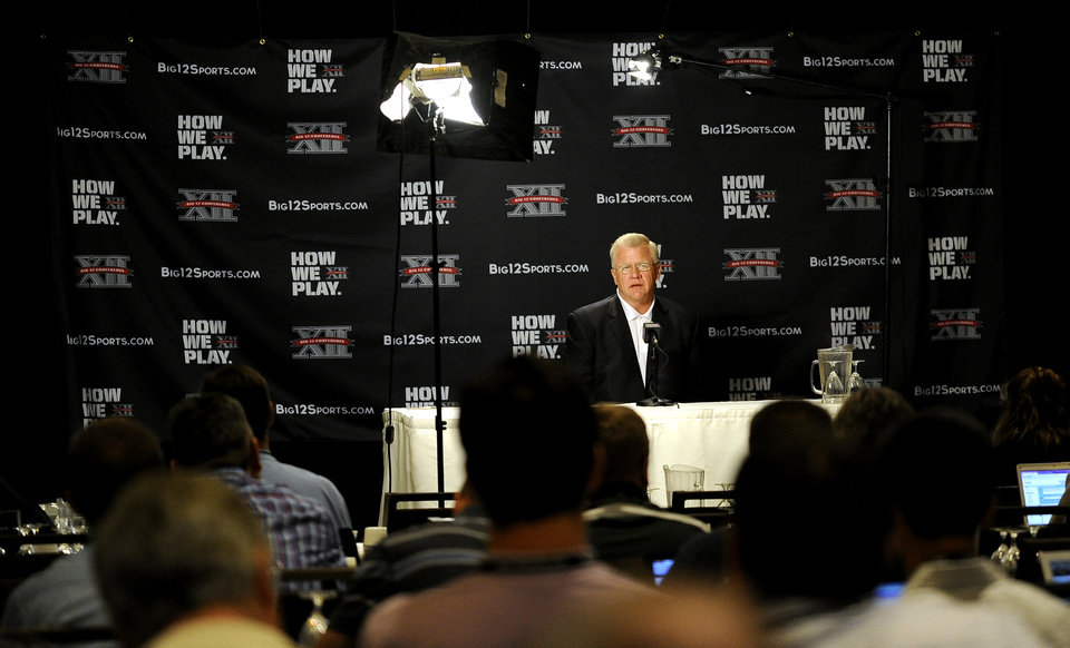 Photo - Texas A&M head coach Mike Sherman answers questions during NCAA college football Big 12 Media Days, Monday, July 25, 2011, in Dallas. (AP Photo/Matt Strasen)