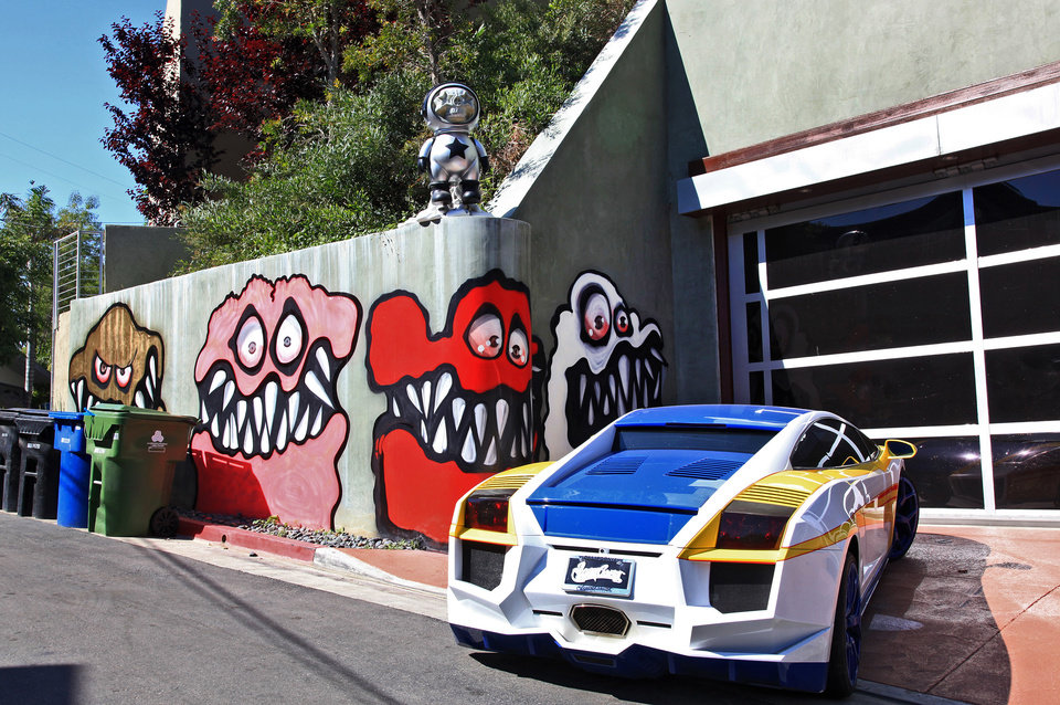 Photo - This Sunday May 12,2013 photo shows a mural painted on the outside of musician Chris Brown's home in Los Angeles. The Grammy-winning musician's neighbors are unhappy with what some are calling frightening art he's chosen to have painted along the curb of his Hollywood Hills home. (AP Photo/Richard Vogel)