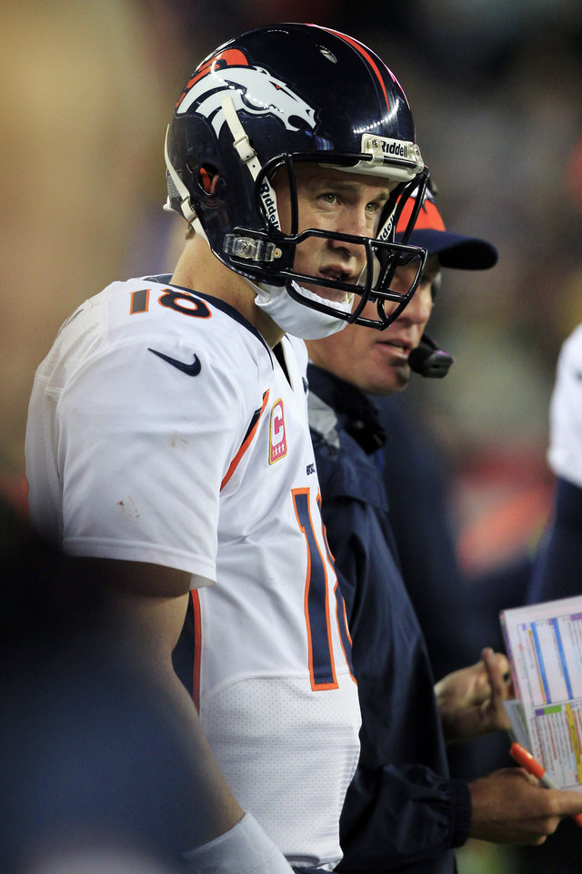 Photo -   Denver Broncos quarterback Peyton Manning watches from the sidelines in the third quarter of an NFL football game against the New England Patriots, Sunday, Oct. 7, 2012, in Foxborough, Mass. (AP Photo/Steven Senne)