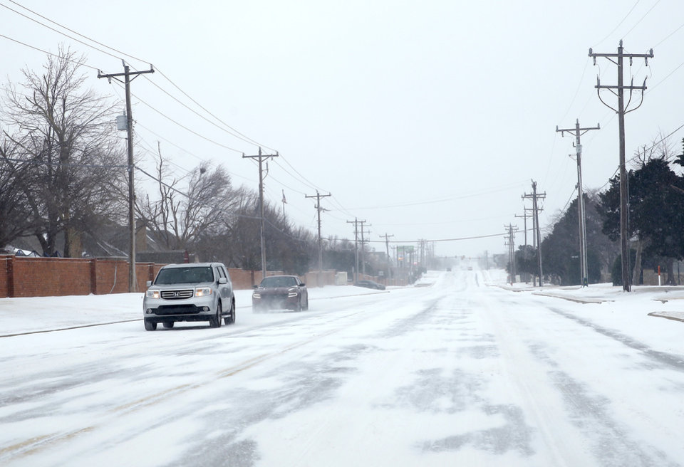 Photo - Cars travel east on NW 164th in northwest Oklahoma City, Sunday, Feb. 14, 2021. Photo by Sarah Phipps, The Oklahoman