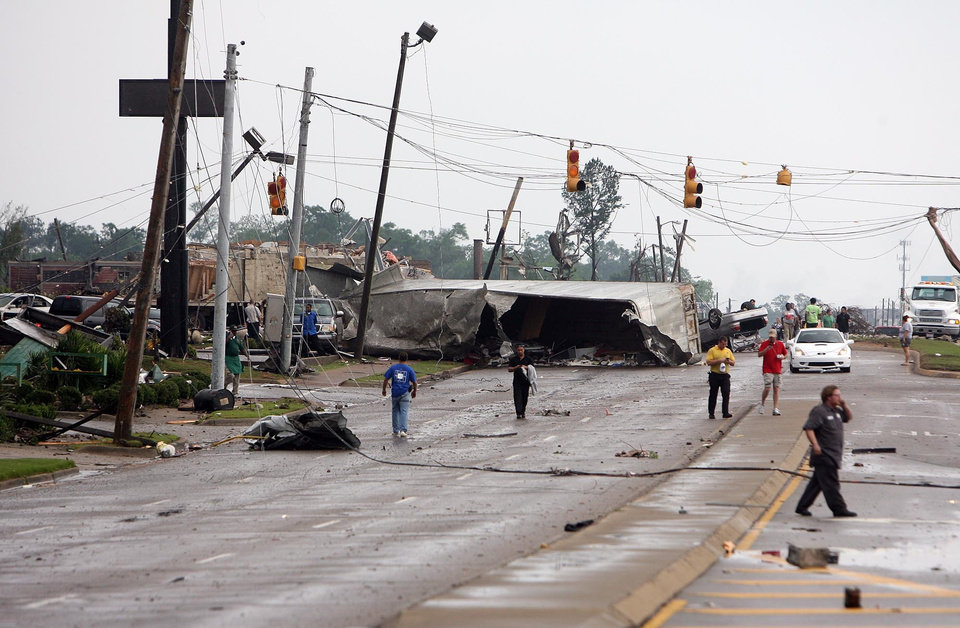Photo - An semi-truck lies on its side on 15th Street after a tornado ripped through Tuscaloosa, Ala. Wednesday, April 27, 2011.  A wave of severe storms laced with tornadoes strafed the South on Wednesday, killing at least 16 people around the region and splintering buildings across swaths of an Alabama university town. (AP Photo/The Tuscaloosa News, Michelle Lepianka Carter)