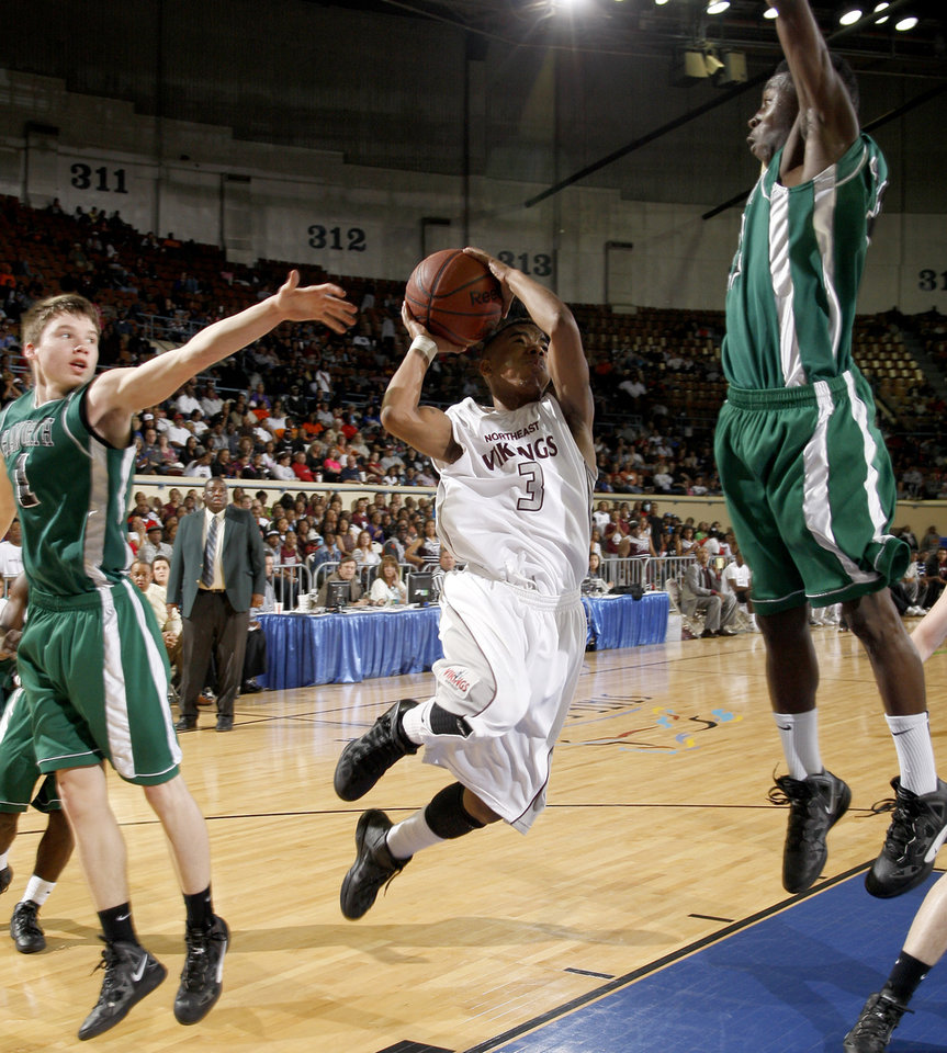 Photo - Northeast's Gabe Houston goes to the basket between Haworth's Hayden Grimes, left, and Victor Fields during the Class 2A boys high school state basketball championship game at State Fair Arena in Oklahoma City, Saturday, March 10, 2012. Photo by Bryan Terry, The Oklahoman
