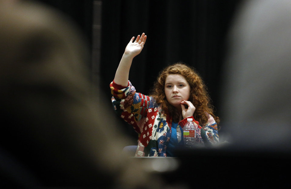 Photo - Norman High School student Marita Ellis waits to be recognized in a question-and-answer session with state schools Superintendent Janet Barresi. PHOTO BY STEVE SISNEY, THE OKLAHOMAN  STEVE SISNEY