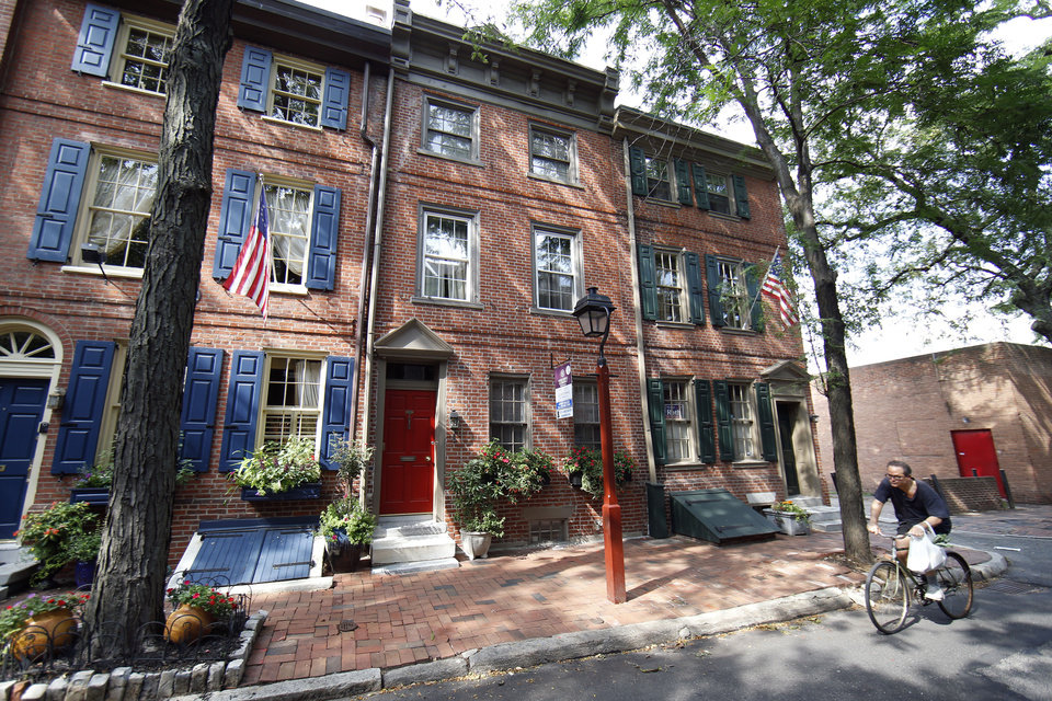 Photo - A row house on a tree-shaded street is for sale and is listed at $995,000 in the Society Hill neighborhood of Philadelphia on Wednesday, July 30, 2014. The 3,200-square-foot home includes four bedrooms, three full and two partial bathrooms and a year of pre-paid garage parking. (AP Photo/Matt Slocum)