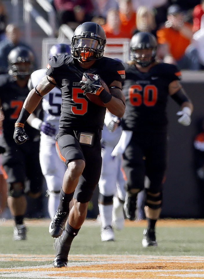 Photo - Oklahoma State's Josh Stewart (5) runs after a reception in the second quarter during a college football game between Oklahoma State University (OSU) and Texas Christian University (TCU) at Boone Pickens Stadium in Stillwater, Okla., Saturday, Oct. 27, 2012. Photo by Sarah Phipps, The Oklahoman