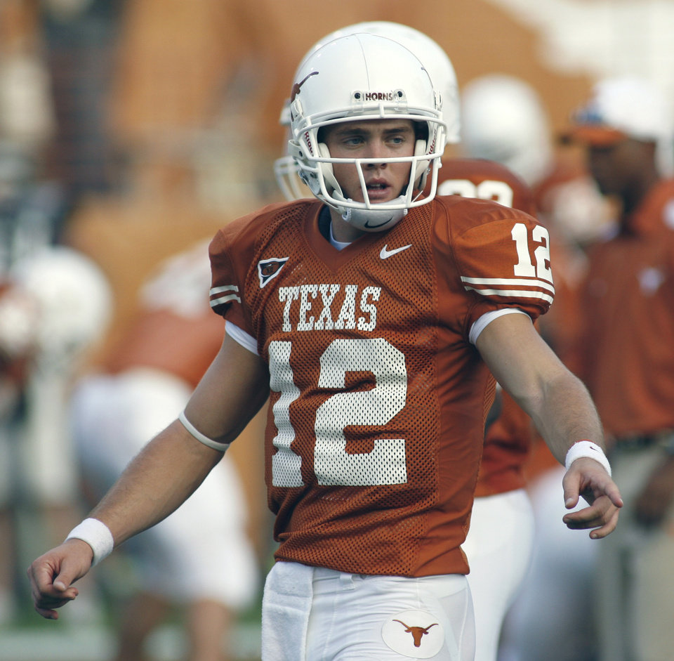 Photo - University of Texas quarterback Colt McCoy points toward a player as he directs him toward the line during the pregame warmup before Texas' 24-7 loss to No. 1 Ohio State in a college football game Saturday night, Sept. 9, 2006, in Austin, Texas. As much as the Longhorns were hoping McCoy could pick up where Vince Young left off, it wasn't realistic. (AP Photo/Harry Cabluck) ORG XMIT: TXHC101