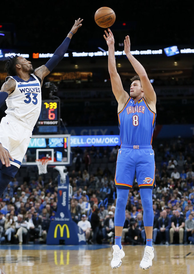 Photo - Oklahoma City's Danilo Gallinari (8) shoots as Minnesota's Robert Covington (33) defends in the first quarter during an NBA basketball game between the Minnesota Timberwolves and the Oklahoma City Thunder at Chesapeake Energy Arena in Oklahoma City, Friday, Dec. 6, 2019. [Nate Billings/The Oklahoman]