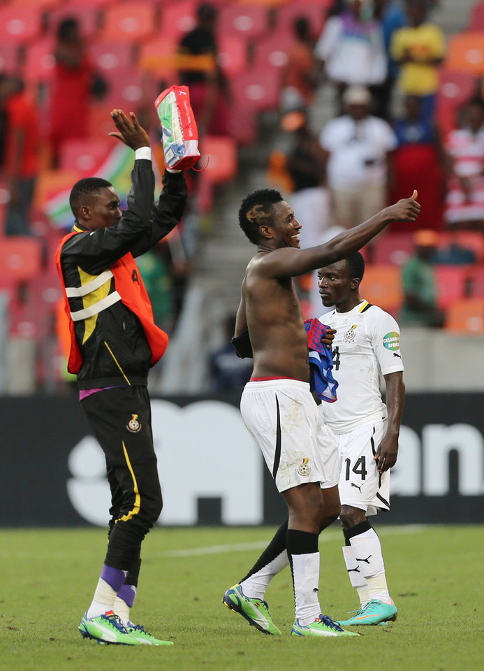Ghana's captain Asamoah Gyan, center, and teammates celebrate winning the quarter final African Cup of Nations soccer match against Cape Verde at the Nelson Mandela Bay Stadium in Port Elizabeth, South Africa, Saturday Feb. 2, 2013. (AP Photo/Themba Hadebe)