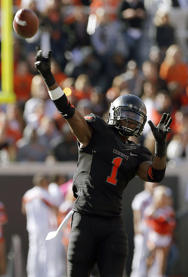 Photo - Oklahoma State's Joseph Randle (1) attempts to throw a pass during a college football game between Oklahoma State University (OSU) and Texas Christian University (TCU) at Boone Pickens Stadium in Stillwater, Okla., Saturday, Oct. 27, 2012. Photo by Sarah Phipps, The Oklahoman