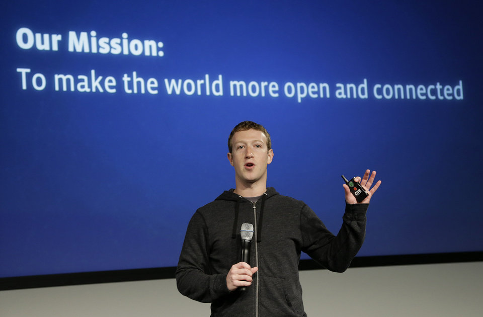 Photo -  Facebook CEO Mark Zuckerberg speaks at Facebook headquarters in Menlo Park, Calif., Thursday, March 7, 2013. Zuckerberg on Thursday unveiled a new look for the social network's News Feed, the place where its 1 billion users congregate to see what's happening with their friends, family and favorite businesses.(AP Photo/Jeff Chiu) ORG XMIT: CAJC102