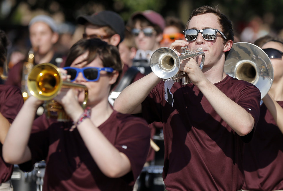 Photo - The Edmond Memorial Marching Band plays during the Edmond LibertyFest Parade in downtown Edmond, Okla., on Independence Day, Friday, July 4, 2014. Photo by Nate Billings, The Oklahoman
