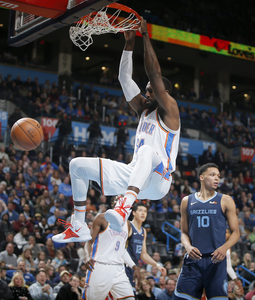 Photo - Oklahoma City's Patrick Patterson (54) dunks during an NBA basketball game between the Oklahoma City Thunder and the Memphis Grizzlies at Chesapeake Energy Arena in Oklahoma City, Thursday, Feb. 7, 2019. Photo by Bryan Terry, The Oklahoman