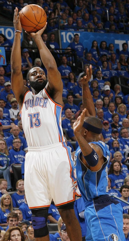 Oklahoma City's James Harden (13) shoots over Jason Terry (31) of Dallas in the first half during game 4 of the Western Conference Finals in the NBA basketball playoffs between the Dallas Mavericks and the Oklahoma City Thunder at the Oklahoma City Arena in downtown Oklahoma City, Monday, May 23, 2011. Photo by Nate Billings, The Oklahoman