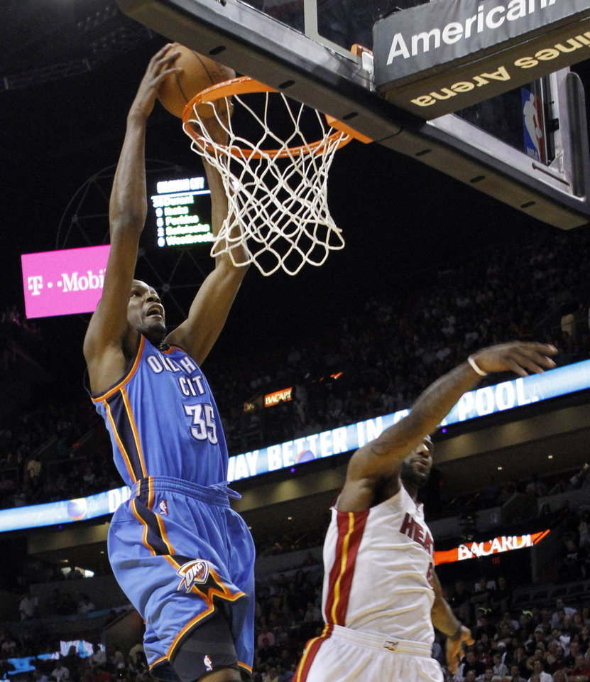 Oklahoma City Thunder's Kevin Durant (35) goes to the basket as Miami Heat's LeBron James, right, defends in the first quarter of an NBA basketball game in Miami, Wednesday, March 16, 2011. (AP Photo) ORG XMIT: AAA102
