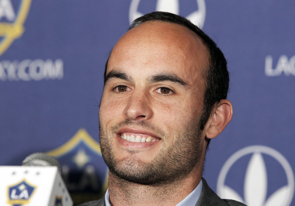 Photo - FILE - This Aug. 28, 2013, file photo, shows Los Angeles Galaxy forward Landon Donovan speaking at news conference in Carson, Calif. Donovan says he will retire from professional soccer at the end of the MLS season. The LA Galaxy forward is widely considered the best soccer player in American history. (AP Photo/Nick Ut, File)