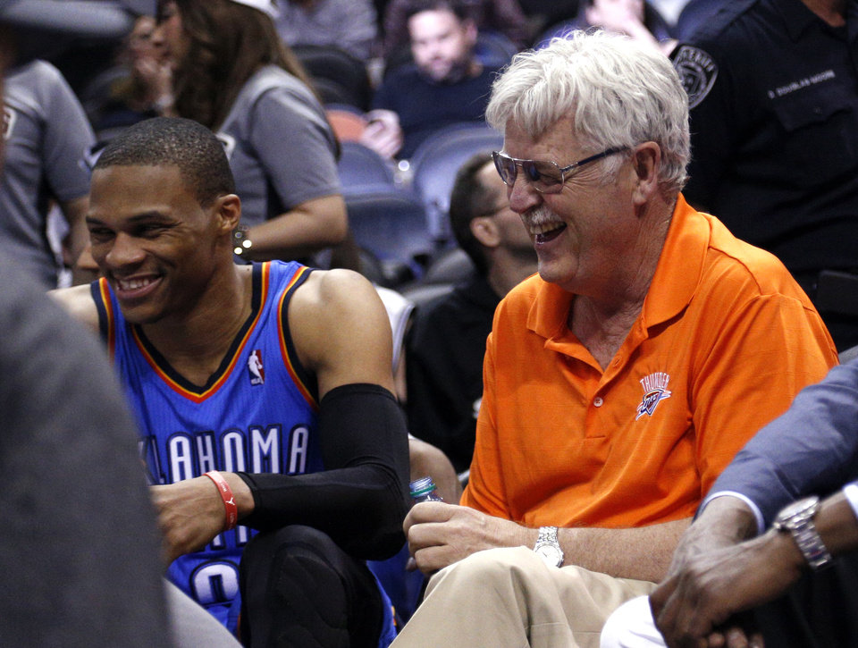 Photo - Russell Westbrook (0) laughs with a fan in the final mite during Game 2 of the Western Conference Finals in the NBA playoffs between the Oklahoma City Thunder and the San Antonio Spurs at the AT&T Center in San Antonio, Wednesday, May 21, 2014. Photo by Sarah Phipps