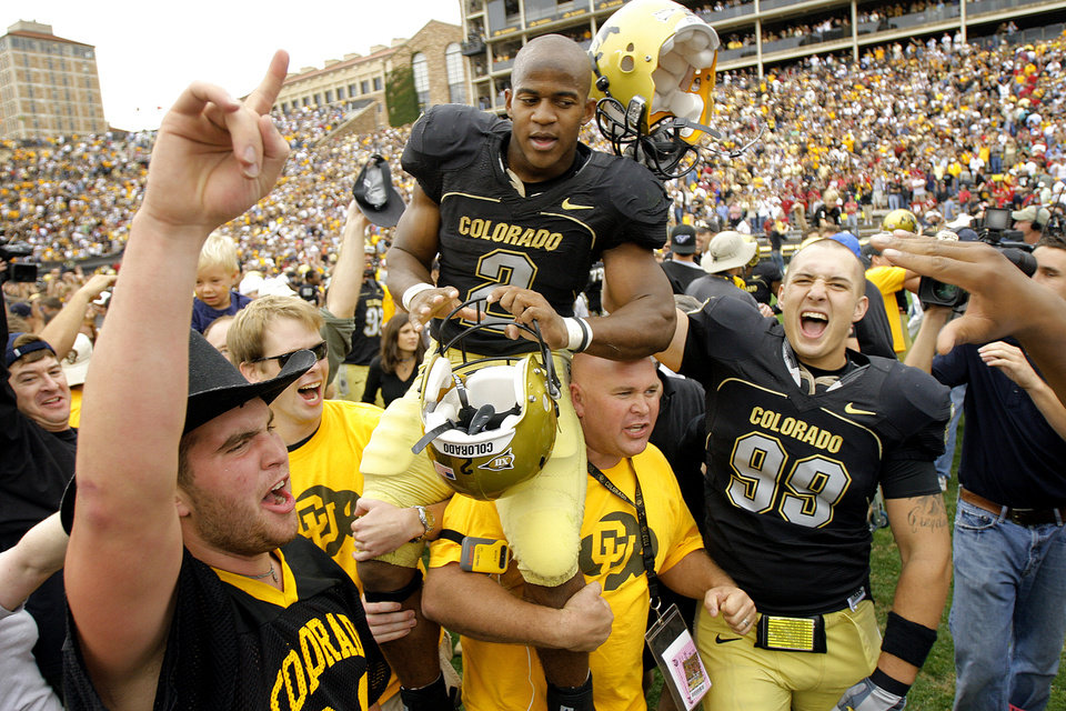 Photo - Colorado tailback Hugh Charles (2) is carried off the field after the Buffaloes upset Oklahoma 27-24 during college football game between the University of Oklahoma Sooners (OU) and the University of Colorado Buffaloes (CU) at Folsom Field on Saturday, Sept. 28, 2007, in Boulder, Co. 