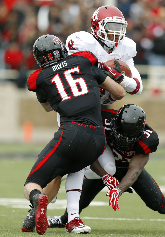 Photo - Oklahoma's Dominique Whaley (8) tries to get past Texas Tech's Cody Davis (16) and Eugene Neboh (31) during a college football game between the University of Oklahoma (OU) and Texas Tech University at Jones AT&T Stadium in Lubbock, Texas, Saturday, Oct. 6, 2012. Oklahoma won 41-20. Photo by Bryan Terry, The Oklahoman