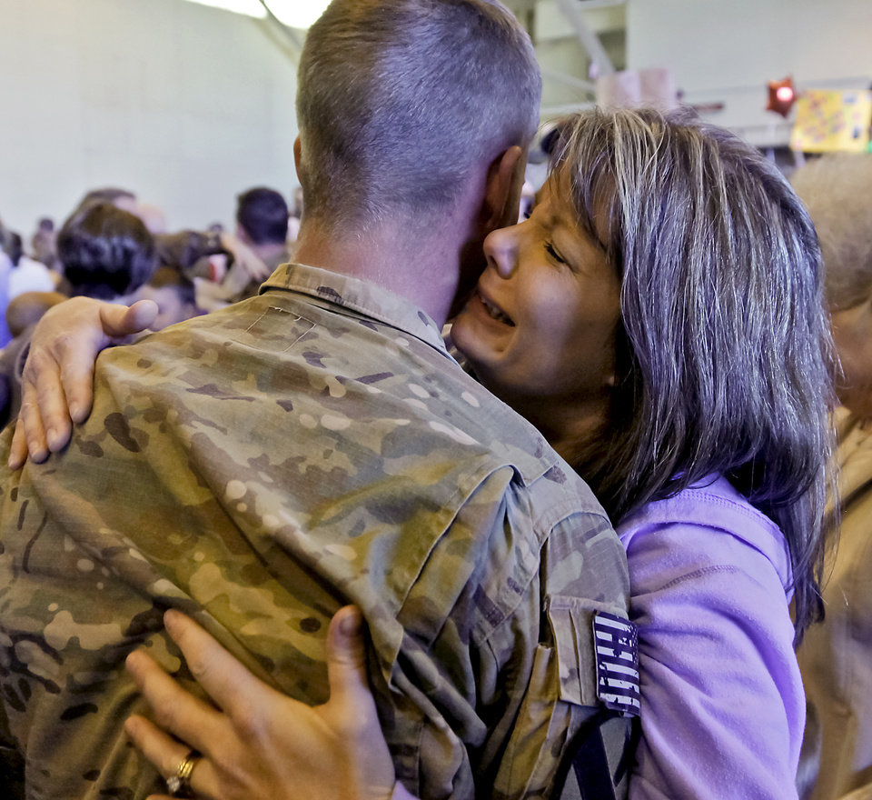 Kristy Brock cries as she hugs her son Justin Farrow during the return ceremony for more than 200 National Guard 45th Infantry Brigade Combat Team troops at the National Guard Base on Monday, March 12, 2012, in Oklahoma City, Oklahoma.  Photo by Chris Landsberger, The Oklahoman