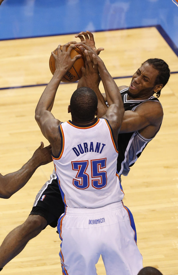 Photo - Oklahoma City's Kevin Durant (35) and San Antonio's Kawhi Leonard (2) fight for a rebound during Game 6 of the Western Conference Finals in the NBA playoffs between the Oklahoma City Thunder and the San Antonio Spurs at Chesapeake Energy Arena in Oklahoma City, Saturday, May 31, 2014. Photo by Nate Billings, The Oklahoman