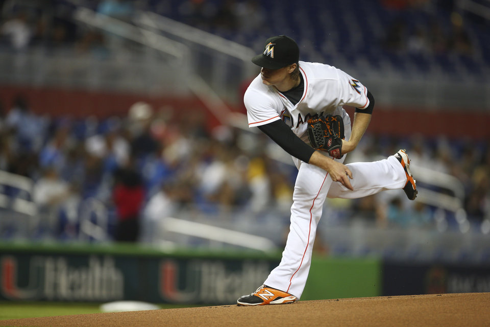 Photo - Miami Marlins starter Tom Koehler pitches to the Chicago Cubs during the first inning of a baseball game in Miami, Monday, June 16, 2014. (AP Photo/J Pat Carter)