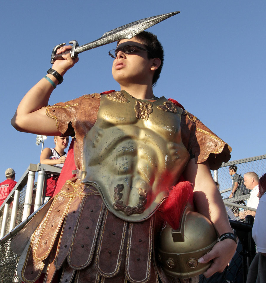 Titan mascot Easton Nibs blocks the 6:30 p.m. sun before the early kickoff as the Carl Albert Titans play the Bishop McGuinness Irish on Friday, Oct. 4, 2013 in Oklahoma City, Okla.  Photo by Steve Sisney, The Oklahoman