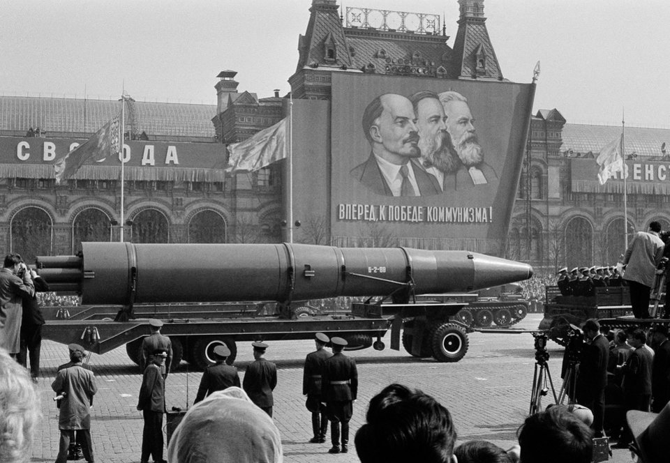 FILE - In this May 1, 1963 file photo, a Naval rocket is exhibited in Moscow\'s Red Square past a banner of Vladimir Lenin, Friedrich Engels and Karl Marx during the annual May Day parade in the Soviet Union. Under the shadow of the Cold War\'s threat of