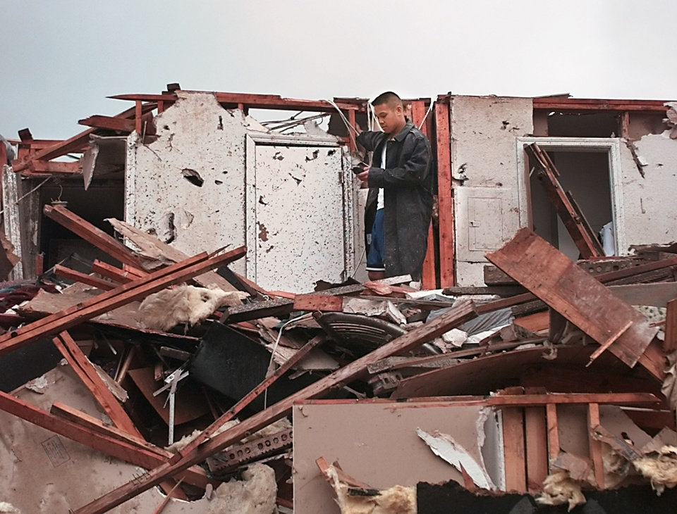 May 3, 1999, Oklahoma City Tornado: Tornado damage: Emerald Springs Apartments, 12500 S Western in Moore across from Westmoore High School, 2nd story gone and pickup buried. Navy Ensign Bernard Calamug, stationed at Tinker, trapped on the second floor of the apartments trying to use a cell phone seconds after crawling out from the closet (shown at right) where he hid from the tornado. Staff Photo by Paul B. Southerland